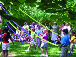 kids at maypole at enchanted woods on enchanted summer day