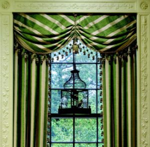 green curtains and bird cage