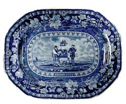 Platter, earthenware with blue printed design depicting the Arms of the State of Delaware.