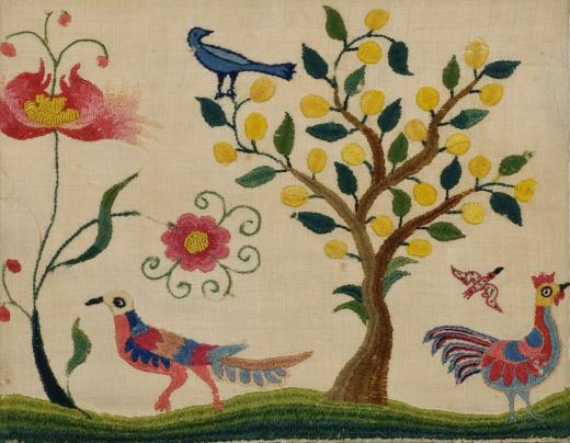 needlework picture of birds and tree