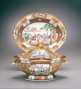 Scenes of Chinese figures in outdoor settings decorate this tureen and stand.